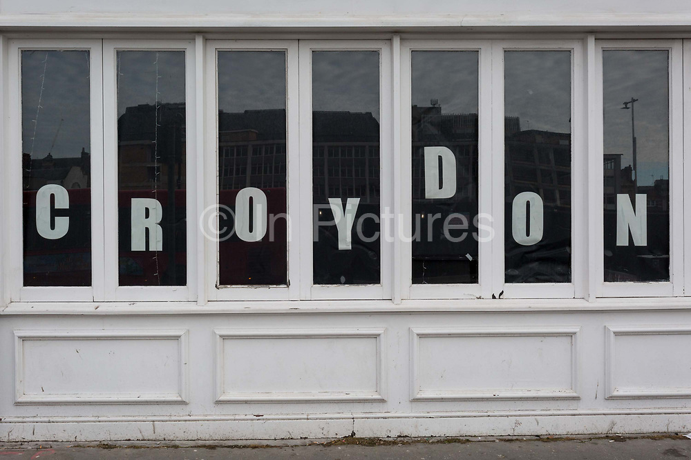 The name of the south London borough Croydon, is spelled out in the window of a local business, on 20th January 2020, in Croydon, London, England.