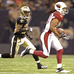 16 January 2010: Arizona Cardinals wide receiver Larry Fitzgerald (11) runs away from New Orleans Saints cornerback Randall Gay (20) during a 45-14 win by the New Orleans Saints over the Arizona Cardinals in a 2010 NFC Divisional Playoff game at the Louisiana Superdome in New Orleans, Louisiana.