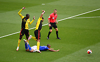 Football - 2019 / 2020 Premier League - Watford vs. Leicester City<br /> <br /> Watford's Abdoulaye Doucoure and Troy Deeney battle with Leicester City's Youri Tielemans, at Vicarage Road.<br /> <br /> COLORSPORT/ASHLEY WESTERN