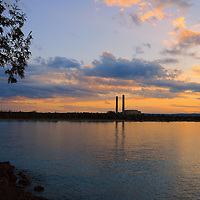 """""""Smoke Stack Sunset""""<br /> <br /> A gentle sunset on calm waters of Lake Superior, looking back onto Marquette from Presque Isle Park."""