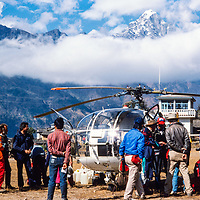 Passengers wait to board a helicopter at Lukla airstrip in the Khumbu region of Nepal 1986.