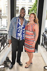 ORLANDO HAMILTON and TARA ZIELEMAN at a private view and launch of the new Heist Gallery at 43 Linden Gardens, London W2 on 12th June 2014.