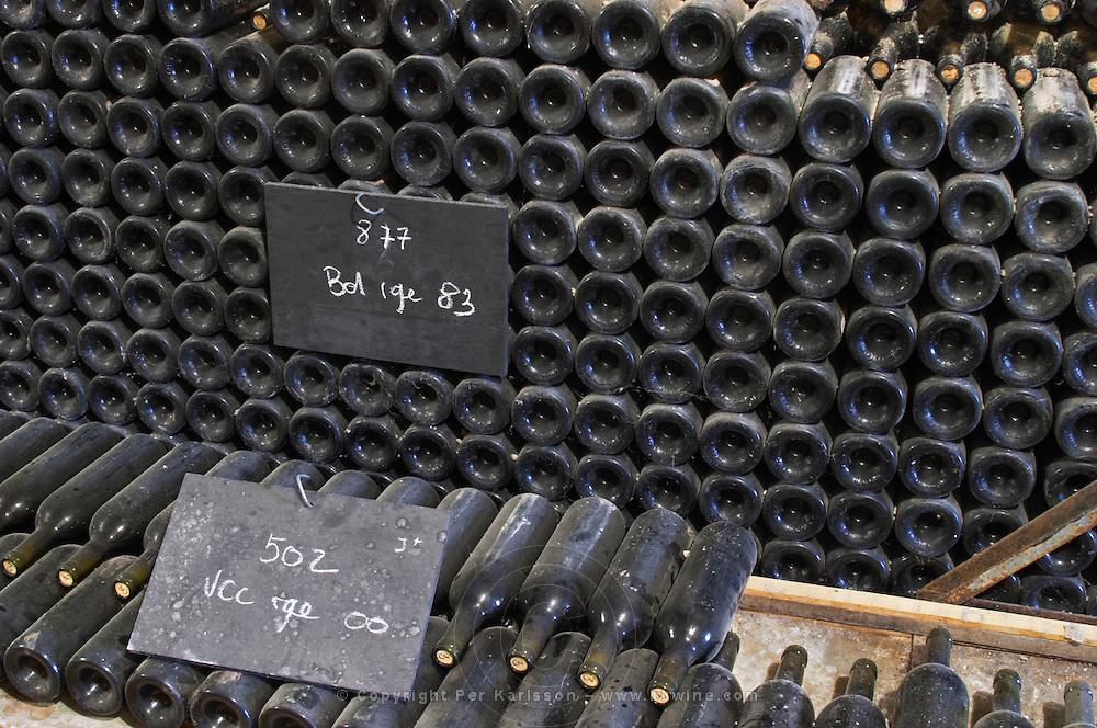Piles of old bottles aging in the cellar, rouge red 1983 and 2000 Chateau Vannieres (Vannières) La Cadiere (Cadière) d'Azur Bandol Var Cote d'Azur France