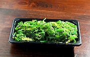 pickled seaweed, isolated on wooden table