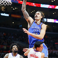 21 December 2015: Oklahoma City Thunder center Steven Adams (12) is called for the charging foul on Los Angeles Clippers guard J.J. Redick (4) during the Oklahoma City Thunder 100-99 victory over the Los Angeles Clippers, at the Staples Center, Los Angeles, California, USA.