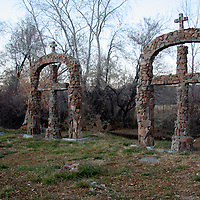USA, New Mexico, Chimayo. stone crosses at Santuario de Chimayo.