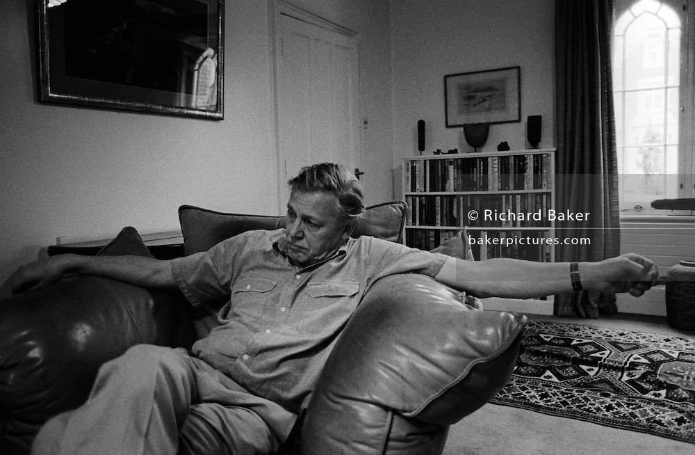 Naturalist and broadcaster Sir David Attenborough watches video of killer whale sequence from The Trials of Life at home in London. Sir David Frederick Attenborough (born 1926) is a British broadcaster and naturalist. His career as the face and voice of natural history programmes has endured for more than 50 years. He is best known for writing and presenting the nine Life series, in conjunction with the BBC Natural History Unit, which collectively form a comprehensive survey of all life on the planet. He is also a former senior manager at the BBC, having served as controller of BBC Two and director of programming for BBC Television in the 1960s and 1970s. Attenborough is widely considered a national treasure in Britain, although he himself does not care for the term. He is a younger brother of director, producer and actor Richard Attenborough.