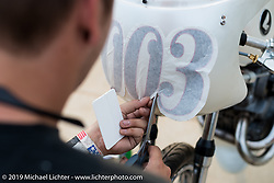Last minute details on a Honda racer during set-up day at the Handbuilt Motorcycle Show. Austin, TX. April 9, 2015.  Photography ©2015 Michael Lichter.