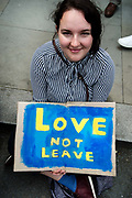 On 2nd anniversary of Brexit , June 23rd 2018, around 100,000 people marched in Central London demanding a People's Vote on the final Brexit deal. A young woman holds a placard saying Love not Leave.