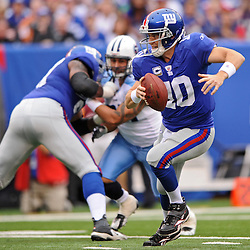 Quarterback Eli Manning #10 of the New York Giants scrambles from the pocket during first half NFL football action between the New York Giants and Tennessee Titans at New Meadowlands Stadium in East Rutherford, New Jersey. The game is tied at half time.
