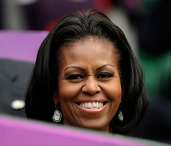 First Lady Michelle Obama watches USA's Serena Williams in action during the first round of the Women's Singles at the Olympic tennis venue, Wimbledon.