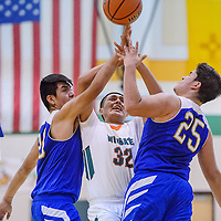 Zuni Thunderbirds Xavier Benevidez (25) and Landers Shalendewa (30) compete with Wingate Bear Manuelito Chee (32) for a rebound Friday at Wingate High School.