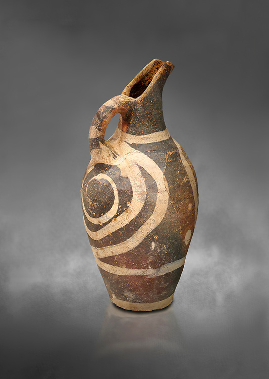 Minoan decorated Kamares  style jug with swirl pattern, Poros cemetery 1800-1650 BC; Heraklion Archaeological  Museum, grey background. .<br /> <br /> If you prefer to buy from our ALAMY PHOTO LIBRARY  Collection visit : https://www.alamy.com/portfolio/paul-williams-funkystock/minoan-art-artefacts.html . Type -   Heraklion   - into the LOWER SEARCH WITHIN GALLERY box. Refine search by adding background colour, place, museum etc<br /> <br /> Visit our MINOAN ART PHOTO COLLECTIONS for more photos to download  as wall art prints https://funkystock.photoshelter.com/gallery-collection/Ancient-Minoans-Art-Artefacts-Antiquities-Historic-Places-Pictures-Images-of/C0000ricT2SU_M9w