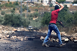 June 2, 2017 - Nablus, West Bank, Palestinian Territory - A Palestinian protester uses a slingshot to hurl stones towards Israeli security forces during clashes following a demonstration against the expropriation of Palestinian land by Israel in the village of Kfar Qaddum, near Nablus, in the occupied West Bank on June 2, 2017  (Credit Image: © Ayman Ameen/APA Images via ZUMA Wire)