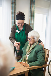 Nursing staff caring about Senior woman in rest home