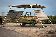 Picnic area in New Mexico's oil patch in Eddy County. The fracking industry revitalized the area. LIke other places in the country, those with mineral rights are reaping the benefits while those without them are negativity impacted by higher prices, dangerous traffic, and worsening air quality .