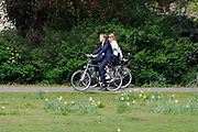 The Dutch prince Willem-Alexander (R) and his wife princess Maxima walk in front of Castle Duivenvoorde in Voorschoten, The Netherlands on 28 April 2010. The royal couple opened the exhibit Tijdloos Trendy (Forever Trendy). The exhibit is one of the activities of the 50th anniversary of the Duivenvoorde foundation. <br /> <br /> On the Photo:  Willem Alexander and Maxima on their bike