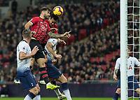 Football - 2018 / 2019 Premier League - Tottenham Hotspur vs. Southampton <br /> <br /> Charlie Austin (Southampton FC ) and Maya Yoshida (Southampton FC ) rise together to attack the header at Wembley Stadium.<br /> <br /> COLORSPORT/DANIEL BEARHAM