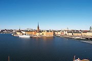 A view over Riddarfjarden water from left to right: Riddarholmen with the white cruise ship hotel and restaurant Malardrottningen (previously owned by the American billionaire Barbara Hutton), the Gamla Stan Old Town and the Centralbron bridge Stockholm, Sweden, Sverige, Europe