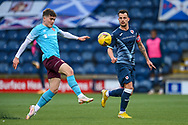 Kyle Benedictus (#6) of Raith Rovers FC watches as Euan Henderson (#31) of Heart of Midlothian FC gets to the ball first during the SPFL Championship match between Raith Rovers and Heart of Midlothian at Stark's Park, Kirkcaldy, Scotland on 30 April 2021.