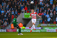 Andrew Butler of Doncaster Rovers (6) heads the ball during the EFL Sky Bet League 1 match between Doncaster Rovers and Coventry City at the Keepmoat Stadium, Doncaster, England on 4 May 2019.
