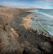 Just 100 km off the coast of Western Africa, Fuerteventura emulates its neighbouring Lanzarote, but perhaps with a less volcanic feel and with splashes of colour throughout. A surfers paradise often attracting adrenalin junkies from around the world but still remaining quiet and untouched for others to reflect and enjoy the abstract aesthetics that one can find throughout this magical gem. Year round sunshine and in our opinion the best beaches one can find in the Canary Islands, it is not surprising that the island was declared a Unesco Biosphere Reserve in 2009