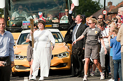 Olympic Torch reaches Sheffield Chapeltown/Ecclesfield/Parson  Cross leg.<br /> Yew Lane and David Blunkett MP and former Home Secretary is there to cheer on  Torch bearer 111 Julie Smethurst who is also<br /> 25 June 2012.<br /> Image © Paul David Drabble