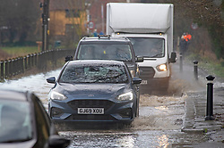 © Licensed to London News Pictures 28/12/2020. Yalding, UK. Vehicles driving through deep floodwater away from the village. Yalding village in Kent and surrounding areas are flooded due to the river Medway and river Beult bursting their banks. Photo credit:Grant Falvey/LNP
