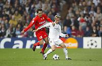 24/3/2004 Madrid, Spain.<br />Champions League. 1/4 Finals, 1 Leg.<br />R.Madrid 4 - AS Monaco 2<br />R.Madrid's  Guti in duel against Monaco's Morientes at Santiago Bernabeu's Stadium.<br />© 2004 Alejandro leon Fernandez