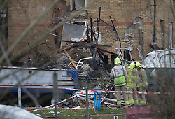 © Licensed to London News Pictures. 15/02/2017. Oxford, UK.  Fire Brigade officers look at the remains of a block of flats damaged in an explosion near Osney Lock in Oxford. A number of people have been injured in what is thought to have been a gas explosion. Photo credit: Peter Macdiarmid/LNP