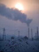 Sonnenaufgang in einer sibirische Winterlandschaft in der Nähe der Stadt Jakutsk. Jakutsk wurde 1632 gegruendet und feierte 2007 sein 375 jaehriges Bestehen. Jakutsk ist im Winter eine der kaeltesten Grossstaedte weltweit mit durchschnittlichen Winter Temperaturen von -40.9 Grad Celsius. Die Stadt ist nicht weit entfernt von Oimjakon, dem Kaeltepol der bewohnten Gebiete der Erde.<br /> <br /> Sunrise in a Siberian winter landscape close to the city of Yakutsk. Yakutsk was founded in 1632 and celebrated 2007 the 375th anniversary. Yakutsk is a city in the Russian Far East, located about 4 degrees (450 km) below the Arctic Circle. It is the capital of the Sakha (Yakutia) Republic (formerly the Yakut Autonomous Soviet Socialist Republic), Russia and a major port on the Lena River. Yakutsk is one of the coldest cities on earth, with winter temperatures averaging -40.9 degrees Celsius.