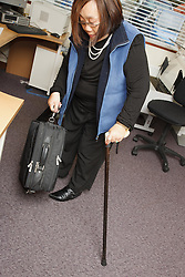 Woman who has long-term illness and reduced mobility following a car accident, helped into employment by the Ready 4 Work team, Nottinghamshire County Council, with walking stick