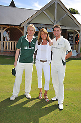 Left to right, team captain ANTHONY BECHER, CAROLE LANGTON and team captain HARRY LANGTON at a cricket match to in aid of CARE - Corfu Animal Rescue Establishment held at Hawkley Cricket Club, Hawkley, Hampshire on 8th September 2012.