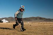 Kazakh boy & toy<br /> Autumn grazing ground<br /> Altai Mountains<br /> Bayan Olgii Province<br /> Western Mongolia