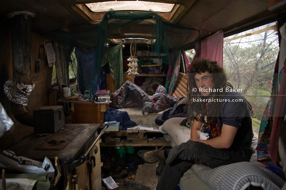 Activist 'Hoosie' aka Robert House, sits in his bus-turned-home early on a Sunday morning at the Faslane Peace Camp.