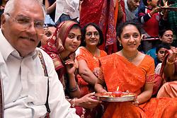 People celebrating Navratri; the Hindu festival of Nine Nights,