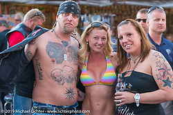 Kristi Verhoff with friends at the Hideaway Grill in Cavecreek, AZ during Arizona Bike Week. USA. April 6, 2014.  Photography ©2014 Michael Lichter.