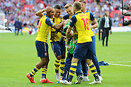 Arsenal players celebrate with Arsenal's Club Photographer during the The FA Cup match between Arsenal and Aston Villa at Wembley Stadium, London, England on 30 May 2015. Photo by Phil Duncan.