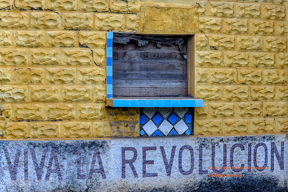 Viva La Revolucion: A worn communist slogan mirrors both the sad state of this building and of the revolution, Baracoa Cuba.