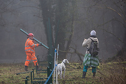 Denham, UK. 6 February, 2020. An engineer working on behalf of HS2 constructs a security fence at Denham Ford. Works planned for the HS2 high-speed rail link in the immediate vicinity include the construction of a Bailey bridge across the ford and a compound in Denham Country Park requiring the felling of mature trees. Some of the site lies within a wetland nature reserve forming part of a Site of Metropolitan Importance for Nature Conservation (SMI).