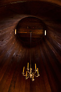 Interior detail of a small wooden chapel at Fort Ross State Historic Park on the coast of Sonoma County, Northern California