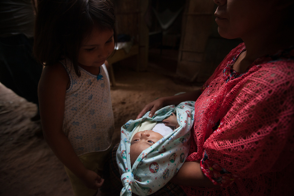 An indigenous Q'eqchi woman with her baby in Concepción Actelá, Alta Verapaz.