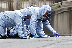 © Licensed to London News Pictures. 24/05/2021. London, UK. Police carry out a fingertip search as they continue to look for clues at Consort Road in Peckham south London after Black Lives Matter activist Sasha Johnson was shot. Ms Johnson remains in a critical condition in hospital after the shooting which happened at 3am on Sunday morning. Photo credit: Peter Macdiarmid/LNP