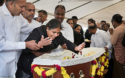 © Licensed to London News Pictures. 04/09/2016. London, UK. Relatives and friends pay respect in a tent holding the coffin of Kurushanth Srithavarajah at a joint funeral held at Winn's Common Park for five men who drowned at Camber Sands last month.  The five men: Kurushanth Srithavarajah, brothers  Kenigan and Kobi Nathan, Inthushan Sri and Nitharsan Ravi were all friends from London.  They got into difficulty in the sea of Camber Sands on August 24. Photo credit: Peter Macdiarmid/LNP