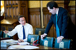 The Prime Minister David Cameron with George Osbourne preparing for PMQs in his office in the House of Commons, London, UK, Wednesday February 16, 2011. Photo By Andrew Parsons / i-Images.
