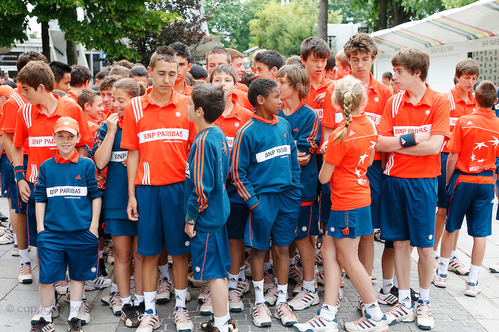 Roland Garros. Paris, France. June 1st 2012.A day with the ball boys..10:00 AM Doors open to the public, ball boys are about to run and sing all over Roland Garros