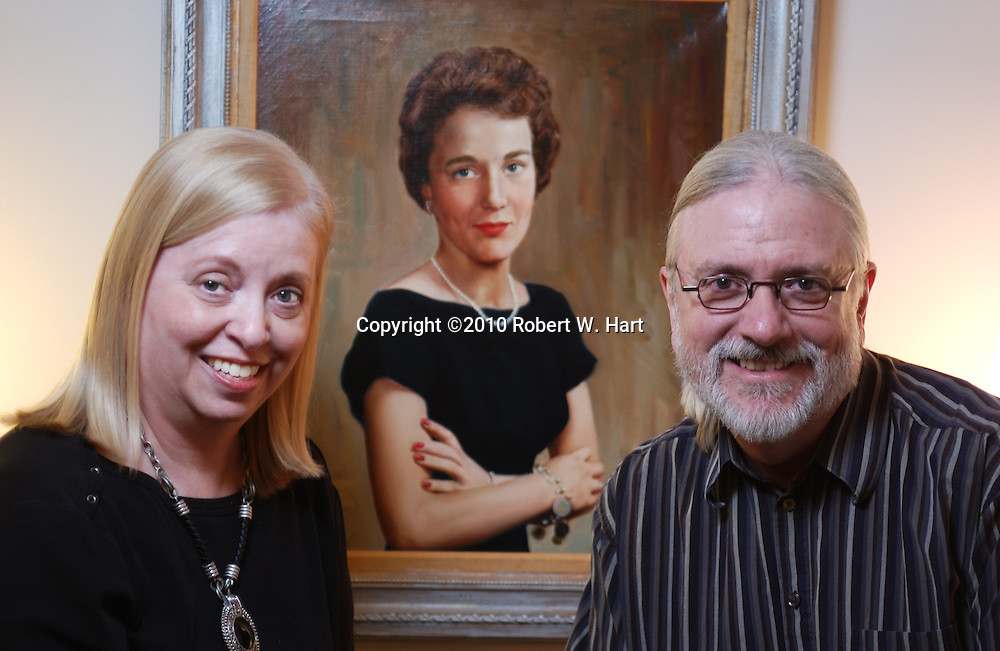 Rose Pearson, left, and Bill Newberry with portrait of co-founder Ann L. Rhodes in the lobby of Circle Theatre on January 11, 2011 in Fort Worth, Texas. Photographer: robert w. hart