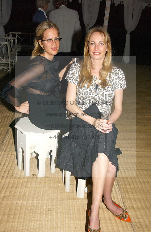 Left to right, CAMILLA LONG and CLEMENTINE HAMBRO at a party to celebrate the publication of Notting Hell by Rachel Johnson held in the gardens of 1 Rosmead Road, London W11 on 4th September 2006.<br /><br />NON EXCLUSIVE - WORLD RIGHTS