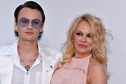 Brandon Lee and Pamela Anderson attend the amfAR Cannes Gala 2019 at Hotel du Cap-Eden-Roc on May 23, 2019 in Cap d'Antibes, France. Photo by Lionel Hahn/ABACAPRESS.COM
