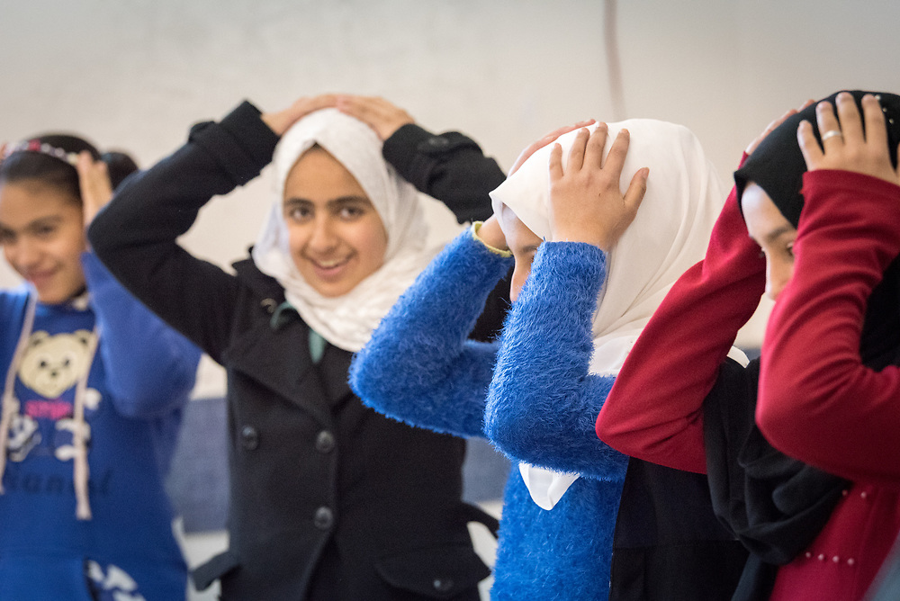 16 February 2020, Irbid, Jordan: A group of girls play a game during a psychosocial support session for Syrian refugee children and Jordanian host communities, led by the Lutheran World Federation at the Islamic Centre in Al-Mazar.